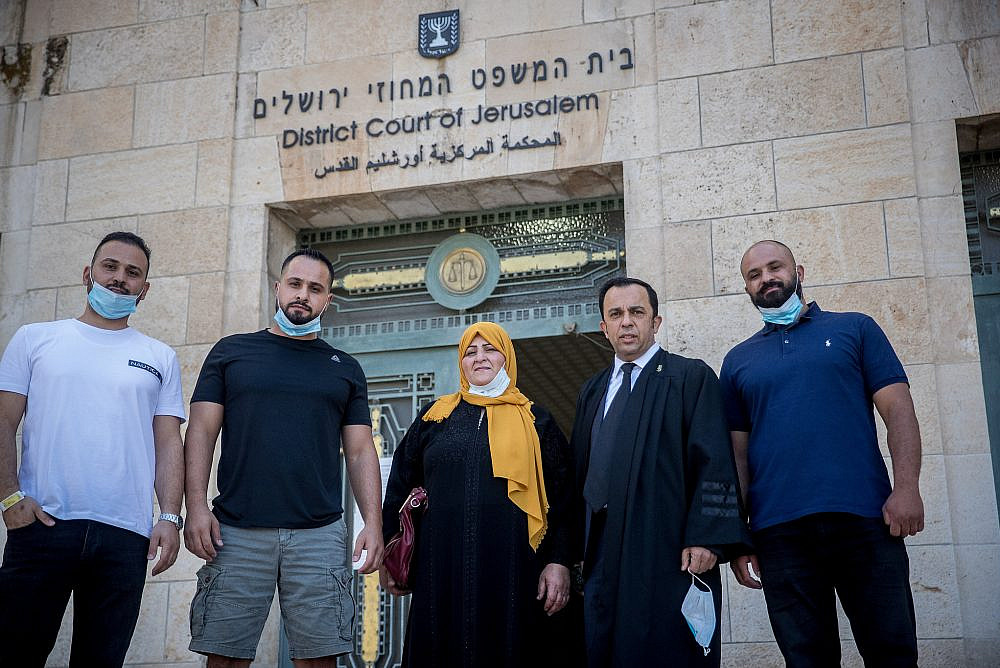 Amal Sumarin, her sons, and their attorney arrive for a court hearing on the JNF-KKL appeal to evict them from their family home at the Jerusalem District Court on June 30, 2020. (Yonatan Sindel/Flash90)
